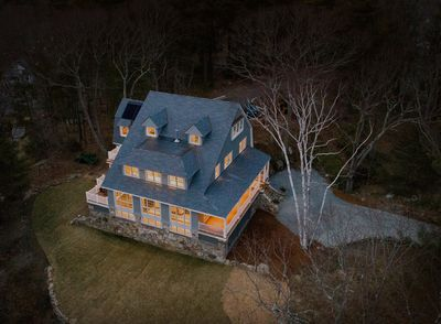 This Old House Gray Lodge Hero Exterior Glowing Aerial