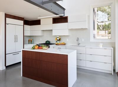 House on the Bluff Hero Interior Kitchen White Cabinets Sub zero Wolf Walnut Windows Modern Contemporary