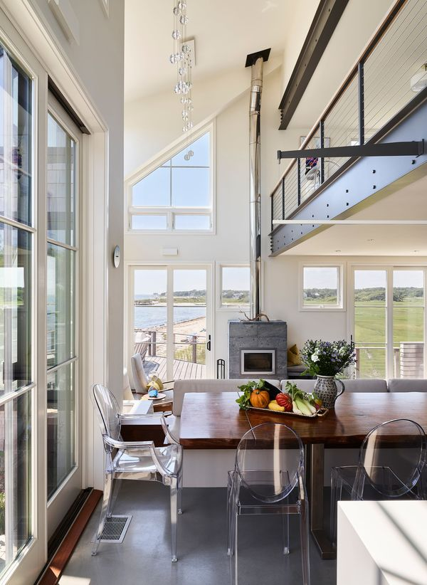 House on the Bluff Tall Interior Kitchen Living Space Steel Beam Windows Cape Cod Interior Design Architecture Modern Contemporary