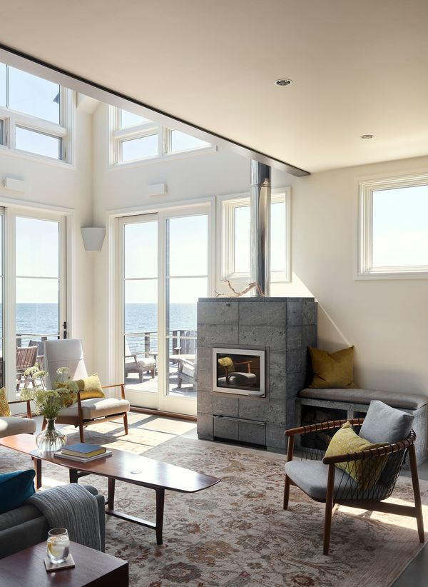 House on the Bluff Tall Interior Living Space Tulikivi Fireplace Cape Cod Interior Design Architecture Modern Contemporary