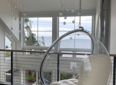 House on the Bluff Hero Hanging Chair Windows Oceanview Waterfront Modern Contemporary Cape Cod Chatham Interior Design Architecture